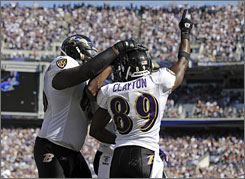 Mark Clayton caught one of Joe Flacco's three touchdown passes on Sunday.