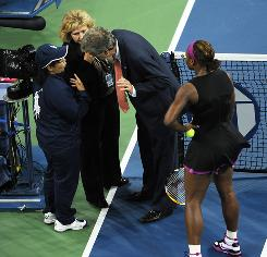 Serena Williams of the USA stands by as tournament referee Brian Earley, Grand Slam supervisor Donna Kelso and the line judge, left, discuss the incident Saturday night in New York. Williams was called for a foot fault and then was docked a point, on match point, after an angry outburst.