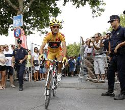 Spanish police watch Vuelta leader Alejandro Valverde at the 14th stage on Sunday.