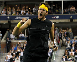 Argentina's Juan Martin del Potro celebrates after winning a point in the fifth set against Roger Federer in the men's final. Del Potro defeated the five-time champion to win his first Grand Slam tournament.