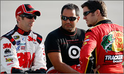 "Greg Biffle, left, talks with Juan Pablo Montoya, center, and Martin Truex Jr., during qualifying at Richmond International Raceway. Biffle says he plans a ""flat-out"" approach for the final 10 races of the season."