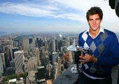 Juan Martin Del Potro takes his trophy to the top of the Empire State Building after his game took him to the top of tennis with his victory against Roger Federer in the U.S. Open.