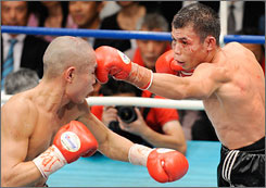Chris John, right, fighting Hiroyuki in a 2008 bout, is on Saturday's PPV undercard. John takes on Rocky Juarez in a rematch.