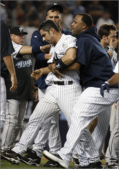 New York Yankees pitchers Andy Pettitte, rear, and CC Sabathia, right, escort teammate Jorge Posada from the field after Posada was involved in an eighth-inning fight with Toronto Blue Jays pitcher Jesse Carlson.
