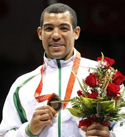 Darren Sutherland of Ireland celebrates with his bronze medal after the men's middleweight final in Beijing.