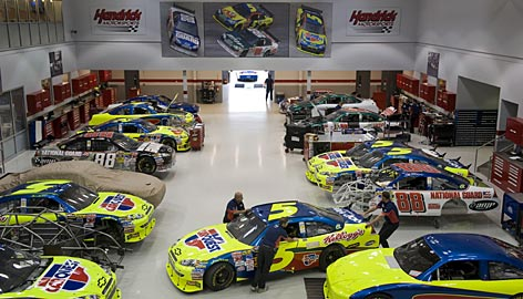 Race cars for Mark Martin and Dale Earnhardt Jr. take their parking places in one of 12 buildings on the sprawling Charlotte-area campus of Hendrick Motorsports.