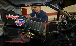 Ricky Vaughn, who heads up driver safety for the No. 5 team, installs a driver's seat in one of Mark Martin's cars. The Hendrick operation builds seats for 30 drivers.