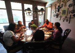 The Jeffcoats have lunch together at their Dallas home after attending church. The family, led by father Jim who played for the NFL's Cowboys, is competitive but remains a tight-knit group.