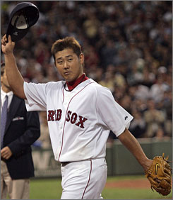 Daisuke Matsuzaka waves to the Fenway Park crowd as he departs Tuesday's game against the Los Angeles Angels. The Boston righthander worked six-plus scoreless innings in his first appearance since June 19.