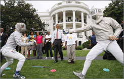 Fencers Tim Morehouse, right, and Daria Schnieder perform a fencing exhibition during a White House rally in support of Chicago's bid for the 2016 Olympics.