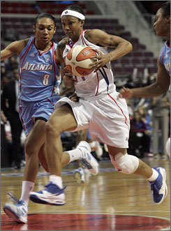 Shock guard Deanna Nolan, right, penetrates past the Atlanta Dream's Iziane Castro Marques during the second half. Nolan scored 25 points to lead Detroit to a 94-89 win.