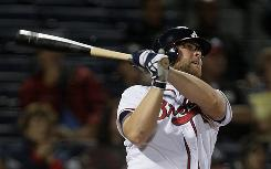 Brian McCann follows through on a three-run homer in the fifth inning of the Braves' 7-3 victory Thursday over the Mets. McCann finished the night with four RBI.