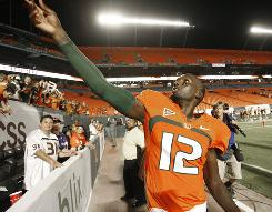 Miami quarterback Jacory Harris throws his sweatbands into the stands after No. 22 Miami defeated No. 13 Georgia Tech 33-17.