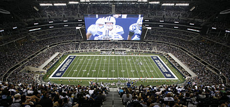 New Cowboys Stadium has a video board that stretches almost 60 yards across the field and drew controversy in the preseason when ex-Titans punter A.J. Trapasso booted a punt into it.