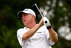 Jay Haas watches his tee shot on the 12th hole during the first round of the Greater Hickory Classic. Haas' score of 62 leads after one round.