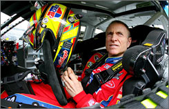 Mark Martin gets belted in for practice sessions at New Hampshire Motor Speedway, site of Sunday's opener to the Chase playoff series.