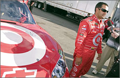 Juan Pablo Montoya speaks with the media after turning a track-record qualifying lap at New Hampshire Motor Speedway.