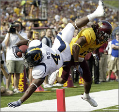 Jahvid Best hurdles into the end zone for one of his five touchdowns for California against Minnesota.