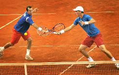 Radek Stepanek, left, and Tomas Berdych of the Czech Republic return a ball against Croatia's Marin Cilic and Lovro Zovko during their Davis Cup match Saturday.