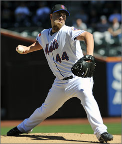 Tim Redding of the New York Mets delivers a pitch in his win over the Washington Nationals on Saturday.