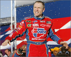 Mark Martin emerges from his car after securing his fifth Sprint Cup victory of the season.