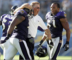 Offensive coordinator Cam Cameron congratulates Ravens LB Ray Lewis after his game-clinching tackle in the fourth quarter.
