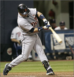 Tigers' Placido Polanco connects for a two-run single off Twins starting pitcher Scott Baker during the fifth inning.