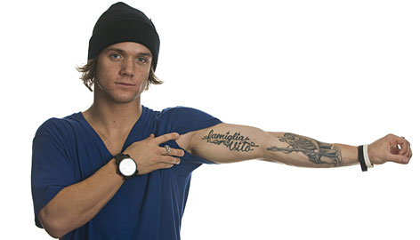 Halfpipe snowboarder Louie Vito shows off some of his tattoos.