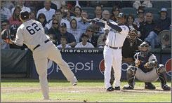Ken Griffey Jr. unloads a three-run homer off New York's Joba Chamberlain on Sunday. Yankees catcher Jorge Posada and plate umpire Chuck Meriwether follow the ball as it leaves Safeco Field.