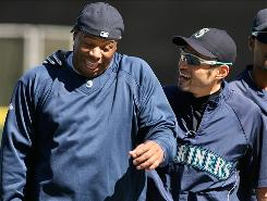 Ken Griffey Jr., left, a known prankster, and Mariners teammate Ichiro Suzuki, sometimes Griffey's target, laugh it up after batting practice before a recent game in Seattle.