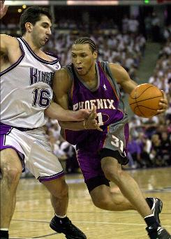 Former Phoenix Suns forward Shawn Marion drives to the basket against the Sacramento Kings during the teams' playoff matchup in 2001. Marion will be reunited this season in Dallas with Jason Kidd. The pair have not played together since their time in Phoenix.