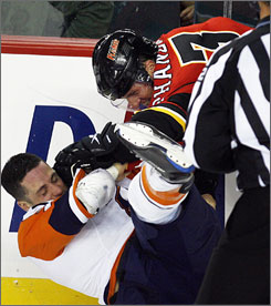The New York Islanders' Pascal Morency, left, shown fighting with Calgary's Dion Phaneuf, was suspended for the rest of the preseason and for the first five regular season games on Monday by the NHL.