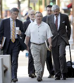 Jerry Moyes, front, majority owner of the Phoenix Coyotes hockey club, arrives Wednesday, Sept. 2, 2009 at Federal Court in Phoenix for a bankruptcy hearing. A federal bankruptcy judge has scheduled an emergency hearing for this Wednesday on a request by Moyes to force the NHL into mediation over the contentious issues surrounding the sale of the team.