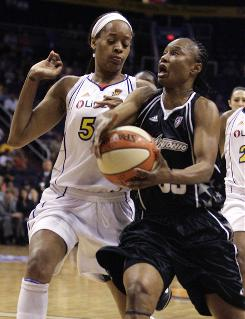 Silver Stars guard Vickie Johnson, right, is fouled by Mercury forward Tangela Smith during the first quarter. Johnson, one of the original members of the WNBA and playing in the final game of her career, scored 24 points.