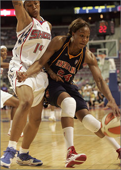 The Indiana Fever and Tamika Catchings, trying to dribble past the Shock's Deanna Nolan, left, face Detroit in Game 1 of the Eastern Conference finals on Wednesday. The Shock have eliminated Catchings and the Fever in each of the last three seasons.