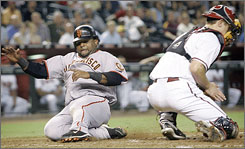 San Francisco's Pablo Sandoval slides home as Arizona catcher John Hester fields the ball during Monday's Giants-D'backs game in Phoenix on Monday.