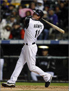 The Rockies' Brad Hawpe follows the flight of his three-run home run against the Padres in the first inning.
