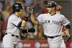 The Yankees Jorge Posada, right, is congratulated by Hideki Matsui after Posada drove him in with a two run homer in the third inning.