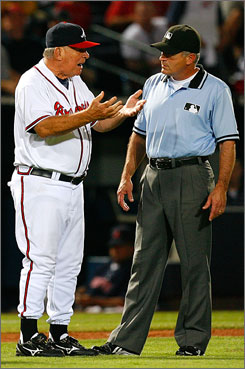 Braves manager Bobby Cox argues a balk call made by third base umpire John Hirschbeck. Cox holds the record for most ejections from a major league game.
