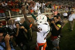 Miami quarterback Jacory Harris celebrates the season-opening victory over Florida State. Harris hopes to lead the Hurricanes to another big win when the team visits Virginia Tech's notoriously tough Lane Stadium on Saturday.