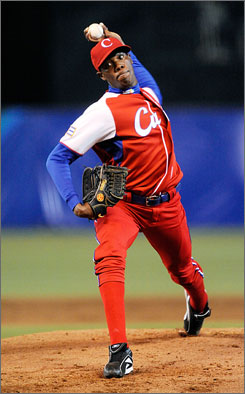 Cuban pitcher Aroldis Chapman pitches against Australia at the World Baseball Classic in March. Chapman defected to the small nation of Andorra in July while the Cuban national team was in the Netherlands.