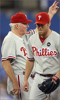 Philadelphia manager Charlie Manuel signals to the bullpen after relieving his No. 1 reliever from 2008, Brad Lidge, who heads for the showers. Lidge's problems are a source of concern for the Phillies for the expected defense of their World Series title next month.