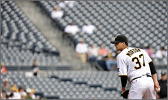 Pirates pitcher Charlie Morton works from the mound before a sparse crowd at PNC Park.