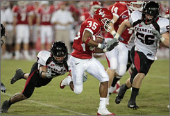 Houston kick returner Tyron Carrier outruns the Red Raiders in the first half.