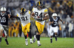 Iowa defensive end Adrian Clayborn runs for a touchdown after blocking a punt against the Penn State Nittany Lions.