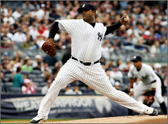 New York Yankees pitcher CC Sabathia delivers a pitch in the first inning against the Boston Red Sox.