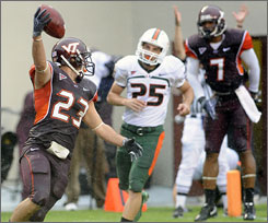 Virginia Tech's Matt Reidy celebrates a defensive touchdown on a blocked punt during the first half.