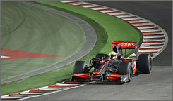 Lewis Hamilton speeds through a curve during his victory at the Singapore Grand Prix.