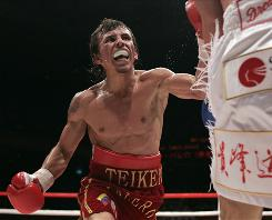 Venezuela's Edwin Valero, left, swings at Japan's Takehiro Shimada during their WBA super featherweight title match in Tokyo on June 12, 2008, which Valero won by technical knockout. Reports indicate that Valero was recently arrested on domestic violence charges.
