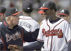 Braves manager Bobby Cox, left, celebrates with reliever Rafael Soriano after he closed Monday's 4-0 victory over the Florida Marlins. Atlanta has won seven consecutive games to move two games off the NL wild-card lead.
